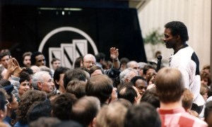 Walter Payton (1953-1999) meeting fans at the Chicago Auto Show.