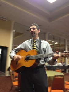Rabbi Ed Bernstein plays guitar in public for first time.