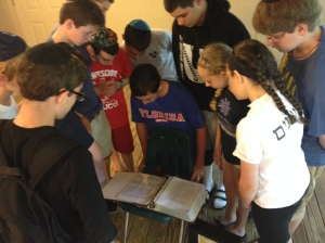 Campers at Ramah Darom examine the Matthew Eisenfeld and Sara Duker Memorial Volume, June, 2015.