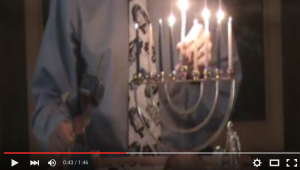 The Jedi Rabbi lights the Hanukkah candles.