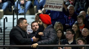 A Sikh protester is removed from a Trump rally.